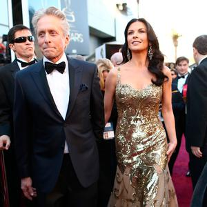 Actor Michael Douglas and his wife actress Catherine Zeta-Jones arrive at the Oscars held at Hollywood & Highland Center on February 24, 2013 in Hollywood, California. (Photo by Christopher Polk/Getty Images)