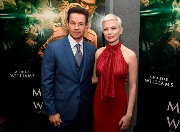 Mark Wahlberg (L) and Michelle Williams attend the premiere of Sony Pictures Entertainment's