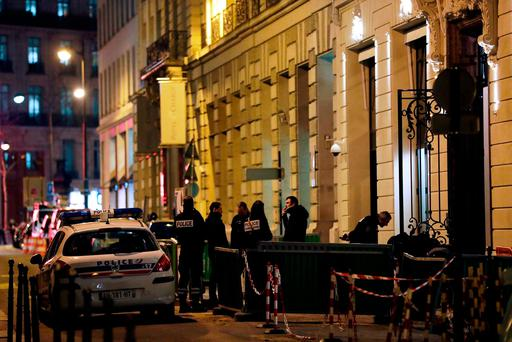 Police stand in rue Cambon at the back entrance of the Ritz luxury hotel in Paris on January 10, 2018, after an armed robbery.