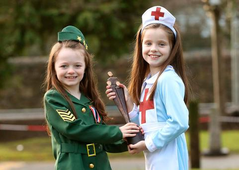 Leah Murray (8), from Newbridge, Co Kildare, and Elianna Martin (7), from Milltown, Co Kildare, play dress-up to launch the People of the Year Awards. Photo: Robbie Reynolds