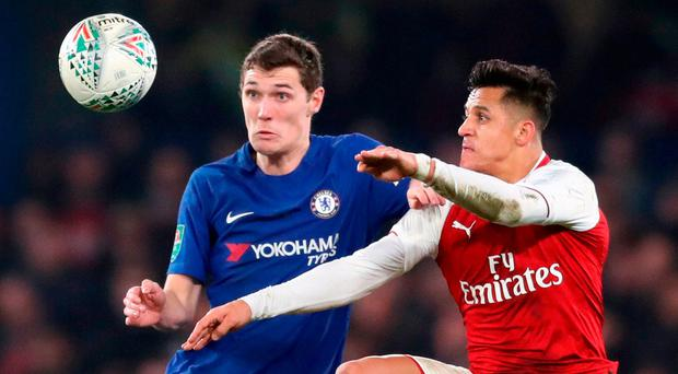 Chelsea's Andreas Christensen (left) and Arsenal's Alexis Sanchez battle for the ball