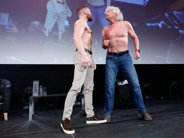Conor McGregor goes toe to toe on stage in a mock brawl with entrepreneur Richard Branson at the Pendulum Summit 2018 in Dublin yesterday. Photo: Conor McCabe