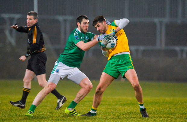 Michael Carroll of Donegal in action against Ryan Jones of Fermanagh. Photo: Oliver McVeigh/Sportsfile