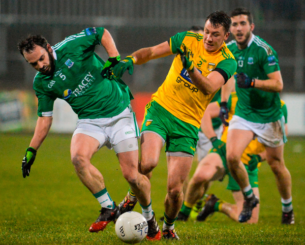 Paul McCusker of Fermanagh in action against Paul Brennan of Donegal. Photo: Oliver McVeigh/Sportsfile