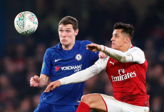 Chelsea's Andreas Christensen and Arsenal's Alexis Sanchez battle for the ball. Photo: PA
