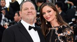 US producer Harvey Weinstein (L) and British fashion designer Georgina Chapman pose as they arrive for the screening of the film