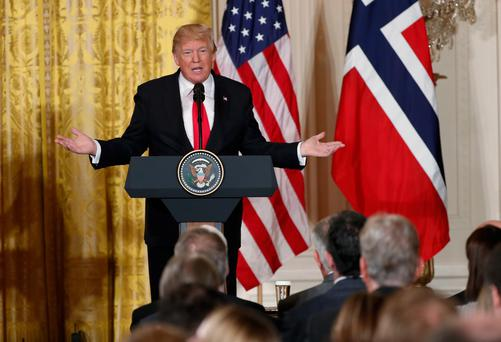 U.S. President Donald Trump holds a joint news conference with Norwegian Prime Minister Erna Solberg in the East Room of the White House in Washington, U.S., January 10, 2018. REUTERS/Jonathan Ernst