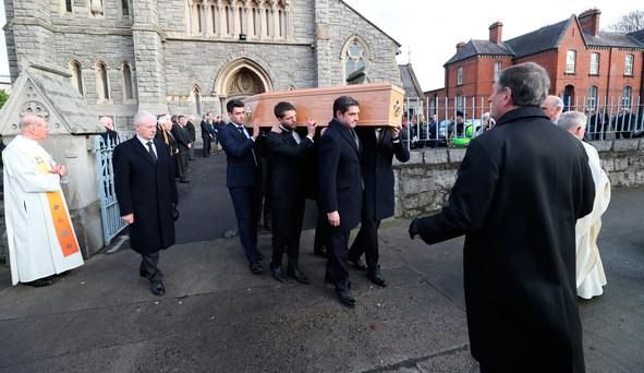 The coffin of former Irish attorney general, leading businessman and international statesman Peter Sutherland is taken from the Church of the Sacred Heart, Donnybrook Dublin following his funeral. Photo : Niall Carson/PA Wire