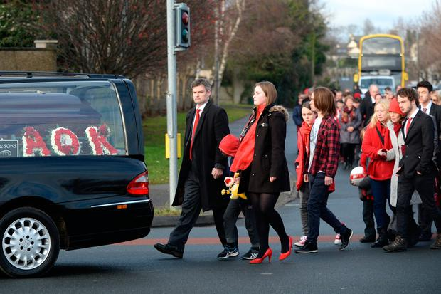 Aaron O'Kelly's funeral yesterday, where mourners were asked to wear the colour red by his family