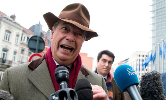 Former UKIP leader and current MEP Nigel Farage speaks with the media outside EU headquarters in Brussels