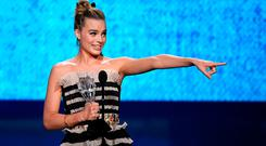 Margot Robbie accepts Best Actress in a Comedy for 'I, Tonya' onstage during The 23rd Annual Critics' Choice Awards at Barker Hangar on January 11, 2018 in Santa Monica, California. (Photo by Kevin Winter/Getty Images)