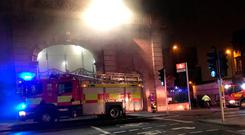 A fire appliance outside Nottingham railway station which has been evacuated and services passing through the station cancelled after a fire broke out. Matthew Vincent/PA Wire