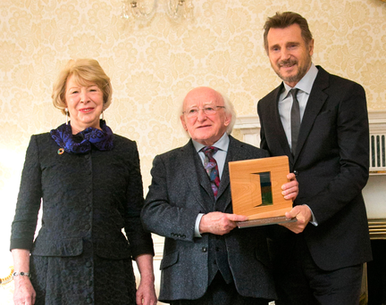Liam Neeson is presented with a Presidential Distinguished Service Award by President Michael D Higgins and Sabina Higgins in Áras an Uachtaráin yesterday Photo: Gareth Chaney