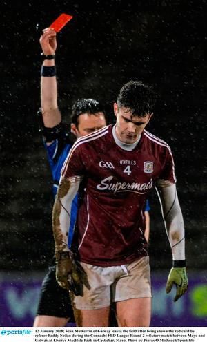Seán Mulkerrin of Galway leaves the field after being shown the red card