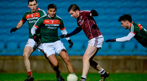 Galway's Pádraic Cunningham is challenged by Mayo's Sharoize Akram, who was making his senior debut, during last night's Connacht FBD League refixtured at Elverys MacHale Park in Castlebar. Photo: Sportsfile