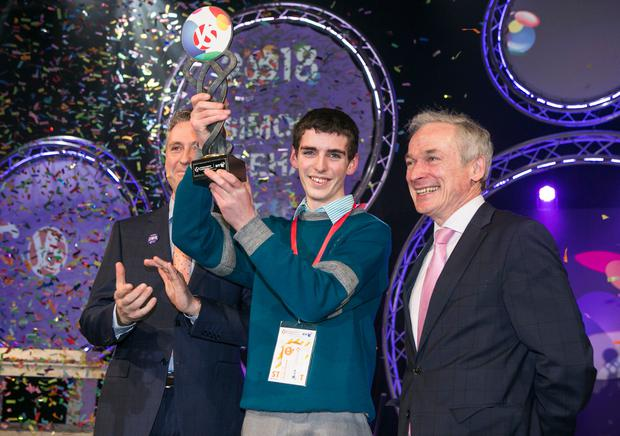 Winner Simon Meehan (15), from Colaiste Choilm, Co Cork, with Education Minister Richard Bruton and BT Ireland managing director Shay Walsh MD Photo: Kyran O'Brien