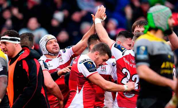 Rory Best of Ulster celebrates with team-mate Darren Cave after his side's third try