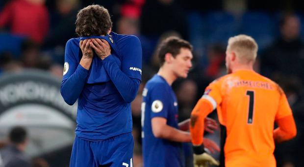 Chelsea's Marcos Alonso looks dejected after the match