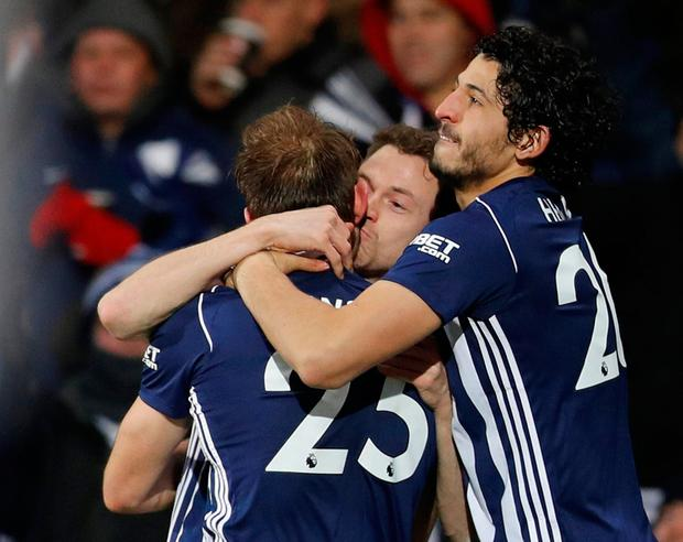 West Bromwich Albion's Craig Dawson celebrates scoring their second goal with Jonny Evans and Ahmed Hegazi