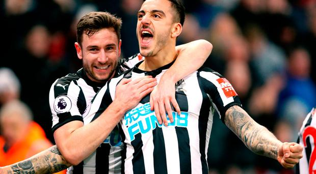 Newcastle United's Joselu (right) celebrates scoring his side's first goal of the game with team mate Paul Dummett