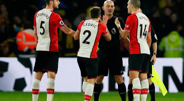 Southampton's Cedric Soares, Jack Stephens and Oriol Romeu appeal to referee Roger East at the end of the match