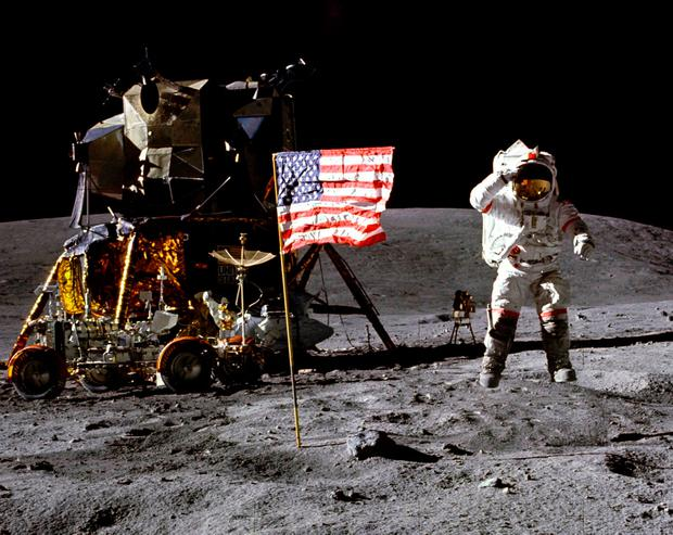 John Young salutes the American flag in 1972 at the Descartes landing site during the first Apollo 16 lunar excursion. Photo: AP