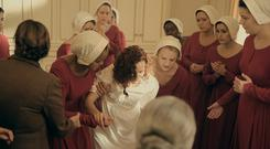 Elisabeth Moss and Madeline Brewer star in 'The Handmaid's Tale', which is resonating so forcefully in the age of Donald Trump