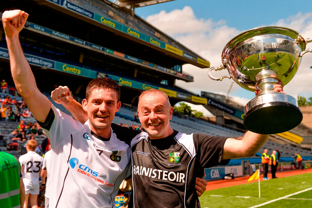 Warwickshire captain Donncha Kennedy and manager Tony Joyce with the Lory Meagher Cup after the Lory Meagher Cup Final in June. Photo: Piaras Ó Mídheach/Sportsfile