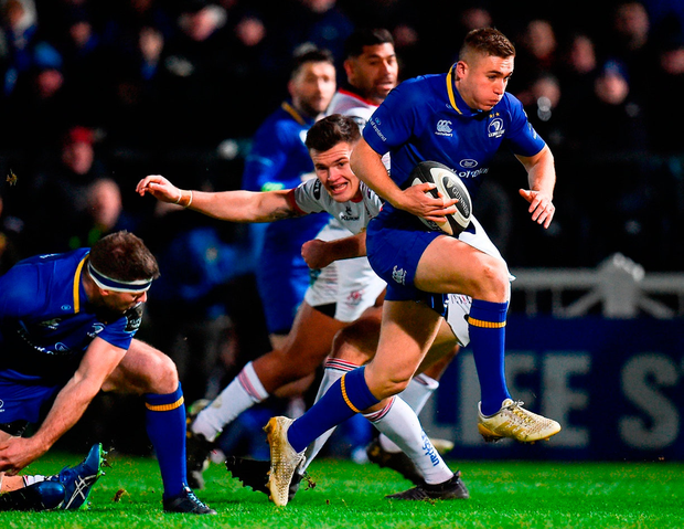 Leinster's Jordan Larmour evades the tackle of another rising star, Jacob Stockdale of Ulster, on his way to scoring a try. Photo: Seb Daly/Sportsfile
