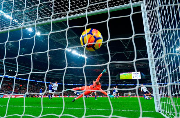 Christian Eriksen of Tottenham Hotspur scores his sides fourth goal Photo: Getty