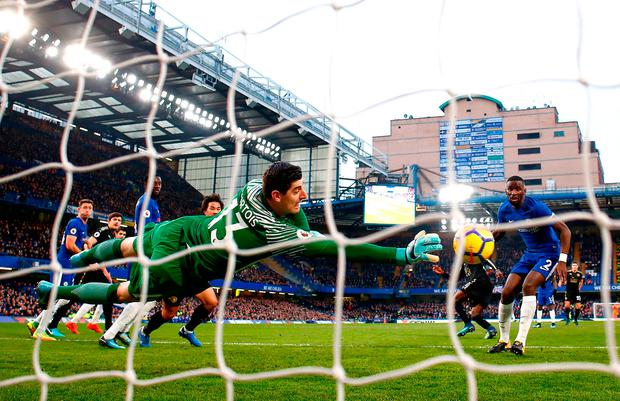 Thibaut Courtois of Chelsea dives to make a save Photo: Getty