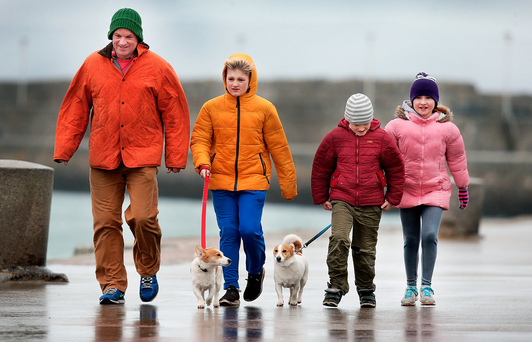 Out for a stroll along the East Pier at Dun Laoghaire yesterday was Niall Gibney from Blackrock, Co Dublin, with children Sasha (11), Rudy (8) and Pia (10) and dogs Rex and Millie. Photo: Steve Humphreys