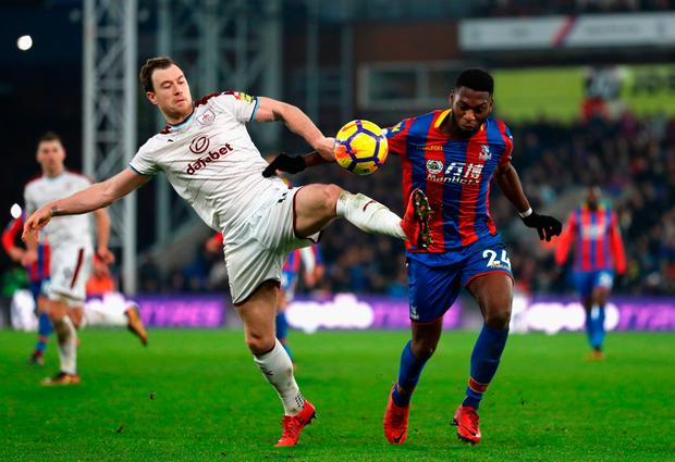 Timothy Fosu-Mensah of Crystal Paalce is challenged by Ashley Barnes of Burnley Photo: Getty