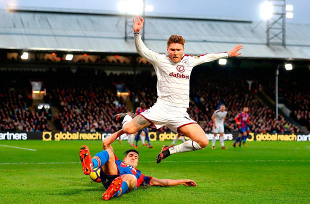 Martin Kelly of Crystal Palace tackles Jeff Hendrick of Burnley Photo: Getty