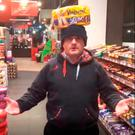 Sinn Fein MP Barry McElduff with a Kingsmill branded loaf on his head