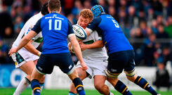 Siua Halanukonuka of Glasgow Warriors is tackled by Scott Fardy of Leinster