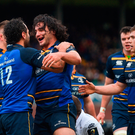 James Lowe of Leinster celebrates with team-mate Isa Nacewa, left, after scoring his side's seventh try