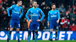 Arsenal's Granit Xhaka and Jack Wilshere look dejected after Bournemouth's Jordon Ibe scores their second goal