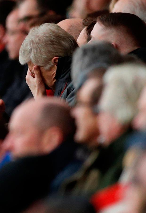 Arsenal manager Arsene Wenger reacts in the stands