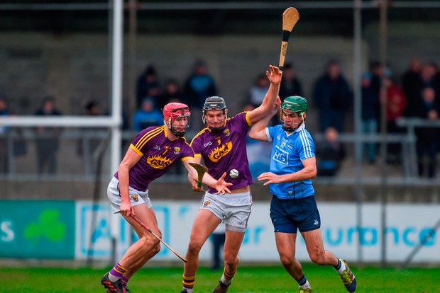 Paudie Foley, left, and Jack O'Connor of Wexford in action against Danny Sutcliffe of Dublin