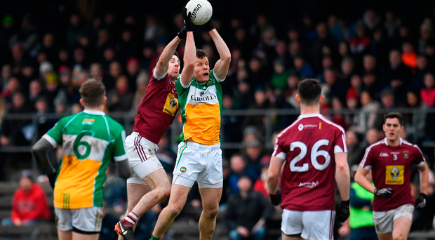 Shane Nally of Offaly in action against Sam Duncan of Westmeath