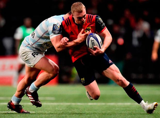 Munster's Irish winger Keith Earls is tackled by Racings French hooker Camille Chat