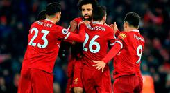 Liverpool's Mohamed Salah (centre) celebrates with team-mates after scoring his team's fourth goal