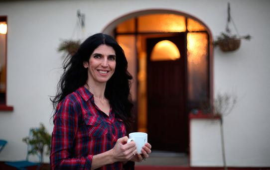 Kathy Donaghy embracing the early morning outside her home in Donegal.Photo: Lorcan Doherty