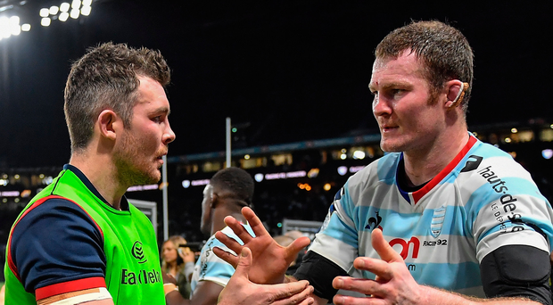 Munster captain Peter O'Mahony congratulates his former team-mate Donnacha Ryan after Racing's victory in Paris. Photo: Sportsfile