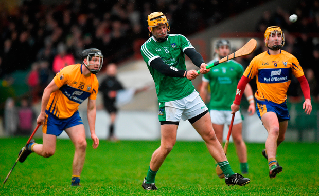 Tom Morrissey of Limerick in action against Jack Browne and Colm Galvin of Clare. Photo: Diarmuid Greene/Sportsfile