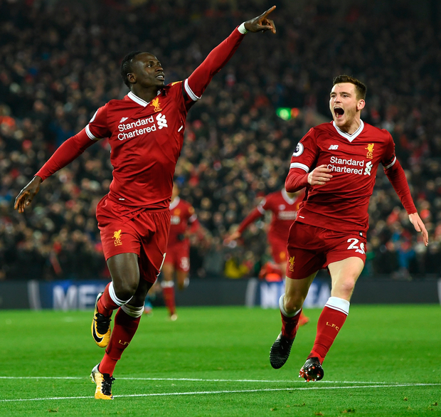 Sadio Mane of Liverpool celebrates with team-mate Andy Robertson after scoring the third Liverpool goal. Photo: Getty Images
