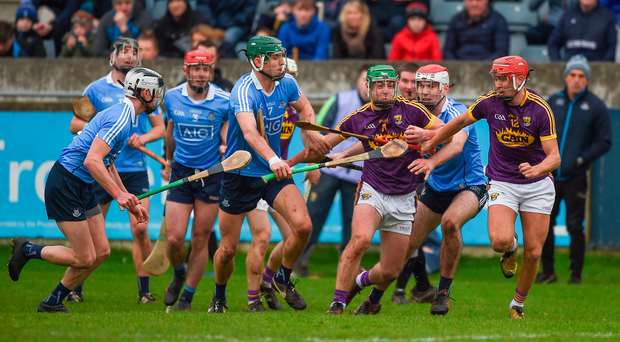 Aidan Nolan of Wexford is chased by five Dublin defenders – led by Chris Crummey (No 7) and Paddy Smyth (far left) – during yesterday's clash in Parnell Park. Photo: Dáire Brennan/Sportsfile
