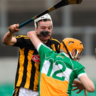 Kilkenny's Padraig Walsh has his helmet dislodged as he challenges Colin Egan of Offaly during Saturday's Walsh Cup clash. Photo: Sam Barnes/Sportsfile