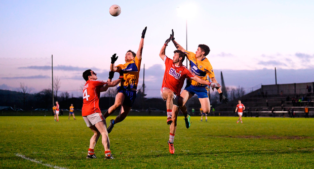 Eimhin Courtney and Gearoid O'Brien of Clare in action against Michael McSweeney and Padraig Clancy of Cork. Photo: Diarmuid Greene/Sportsfile
